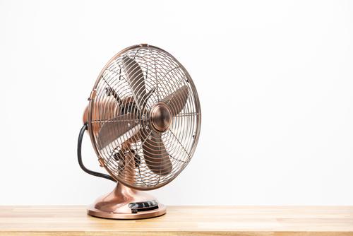 Ancien ventilateur couleur bronze